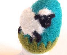 How cute is this? A sheep on a felted egg on Etsy.