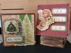 Two christmas cards based around wooden shape, stamped with colour and added kaisercraft collectables. merry christmas, peace, love, joy, trees, angels, candle, snowflake.