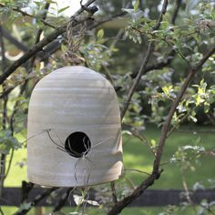 Bring the birds and the bees together! This hive inspired bird house hangs out all season long and blends in with it's natural surroundings. Style #: POT103 Han