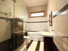 Large white tiles, smaller black tiles forming a strip around room Bathroom Photos, Bathroom Layout, Modern Bathroom Design, Bathroom Interior Design, Decor Interior Design, Modern Bathrooms, Bathroom Designs, Beautiful Bathrooms, Bathroom Ideas