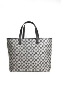 caa5eef293 This authentic Gucci Large Black and White Leather 257245 handbag comes  directly from designer boutiques