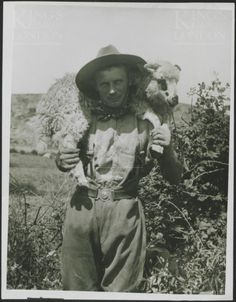 Photograph of an ANZAC soldier carrying goat captured from Turkish trenches, Achi Baba. No 2596. From a collection of official photographs of the Dardanelles Expedition, 1915-1916.