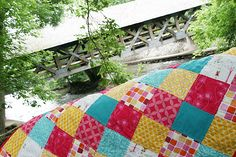 yellow, pink, turquoise and white quilt