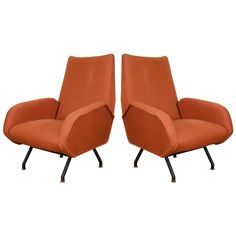 Midcentury Pair of Italian Rust Colored Lounge Chairs | From a unique collection of antique and modern lounge chairs at https://www.1stdibs.com/furniture/seating/lounge-chairs/