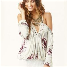 Free People Adelia Rose Print Cold Shoulder Blouse A striking floral motif punctuates this shoulder-flaunting blouse detailed with lace embroidery at the back and billowing sleeves.   📌All Free People 30%-50% off💸💰 ❌Trades/🅿️🅿️ 📬Fast shipping✈️ 👗New with tags Free People Tops Blouses