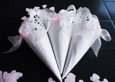 White Lace Paper Wedding Cones with Pink Organza Bow by IlasPaper, €27.50  Make your paper feather cones out of a round white paper doily...