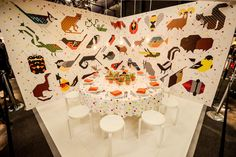 At the Designtex table, a white floor and simple three-legged stools kept the focus on the 12 wall coverings and textiles developed with Tod... Photo: Gustavo Ponce for BizBash