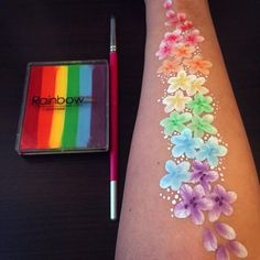 Here is a quick little arm design that is perfect for teenagers, adults, and kids that don't like their face painted. This is my very first video so it is not Body painting Rainbow Flowers Arm Design Face Painting Tutorials, Face Painting Designs, Paint Designs, Leg Painting, Adult Face Painting, Face Painting Flowers, Body Painting Girls, Body Paint Art, Diy Face Paint