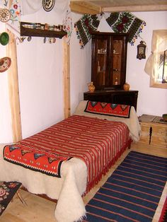 Take inspiration from traditional European farmhouse interiors like this Romanian traditional interior. Simple wood floors, and furniture with an abundance of bright colours and predominance of red in traditional woven designs. R McN Rustic Design, Rustic Decor, European Decor, Interior Decorating, Interior Design, Traditional Interior, Farmhouse Interior, Bright Colours, Folklore
