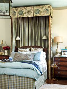 A lovely canopy frames the traditional bed, adding dramatic height and making it a true focal point in the room.