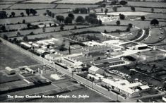 An aerial photograph of the Urney chocolate factory. The company was established in Urney, Co. Tyrone in 1919 by Harry and Eileen Gallagher and relocated to the Belgard Road, Tallaght, Co. Dublin in 1924. It went on to become one of Europe's largest chocolate factories employing nearly 1,000 staff. The business was purchased and the factory eventually closed in 1980.