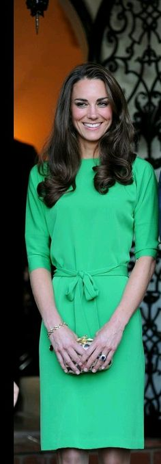 Kate Middleton in a cocktail green dress.