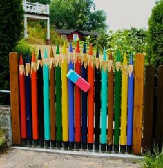 We've showed you the fence before, but I much prefer the gate.How about you?   on The Owner-Builder Network  http://theownerbuildernetwork.com.au/wp-content/blogs.dir/1/files/colour-in-landscaping/Colour-In-Landscaping-13.jpg