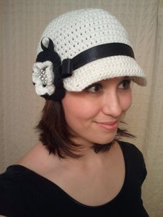 Crochet newsboy hat with ribbon and flower. Actually quite cute! #newsboyhatcrochet