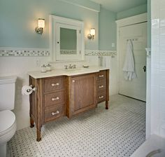 love the color of the vanity, the tile border, med cabinet, floor tile and wall color - just a lovely room