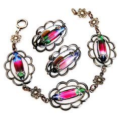 J-3579 JayKel Sterling Iris Glass Retro Demi Parure c.1940    Dark iris glass or watermelon stones are the focal point of this pretty bracelet and earring set