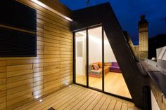 slim minimal windows lead out onto the small upper storey balcony in the new roof top extension Aluminium Sliding Doors, Sliding Door Systems, Sliding Glass Door, Mews House, Replacement Canopy, Wooden Pergola, Modern Loft, Glass Roof, Types Of Houses