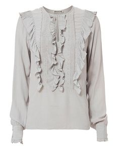 St. Roche Katy Ruffle Bib Shirt: Ruffled bib and long button sleeve cuffs. Keyhole neckline. In ice. Fabric: 100% viscose Trim: 100% cotton Imported.  Model Measurements: Height 5'8.5 ; Waist 24 ; Bust 33 wearing size S   Length from shoulder to hem: ...