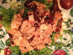 Wild Alaskan salmon with diced apples, sun dried tomatoes, lemon and ACV over arugula salad. So nutritious!