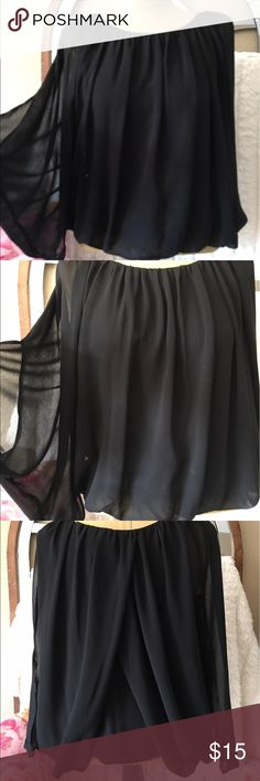"""Love Stitch black flowy top shirt medium Love Stitch black flowy top/shirt size medium. Pulls over your head and has lots of room. It's supposed to be loose and flowy. Elastic waist and body is lined but sleeves are not. A bit hard to measure but 19"""" arm pit to arm pit, 24"""" shoulder to hem, measures 26"""" across if I spread the fabric of shirt all out. 💯polyester. Love Stitch Tops Blouses"""