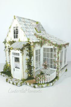 """I called this newest dollhouse """"In Tatters"""". It's another shabby chic style. This one has a little terrace to sip your morning coffee. ..."""