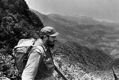 Cuban Prime Minister Fidel Castro looks over the Sierra Maestro mountains as he revisits the area where his revolution started in this June 1962 photo in Cuba. (AP Photo/Revolucion, Korda).
