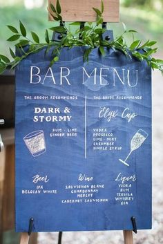 classic blue wedding blue board with greenery and bar menu