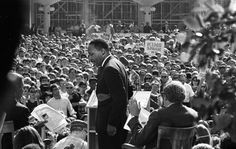 """Martin Luther King, Jr. speaking at Berkeley campus (1967) Both the fliers in the hand of the man on the left, and signs in the crowd, pushed for """"King/Spock in '68."""" They're referring to a possible presidential ticket with Dr. Benjamin Spock."""