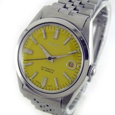FELCA DATE AUTOMATIC WATCH  Feature : Center Second, Date, Water And Shock Protected, Automatic Watch Dial Features : Repainted Dial Dial Color : Yellow Markers : Steel Arrow Figures Case Material : Standard Stainless Steel Case Whit Steel Belt Crown : Pull Band Type : Steel Belt Hands : Steel And Radium Hands Movement : Automatic Gender : Gents Machine No. : 2784 Back No. : 9582-1 Serial No. : - Jewels : 25J  Case Diameter Size : 3.5 cm Side To Side Size : 3.9 cm (Including Crown)