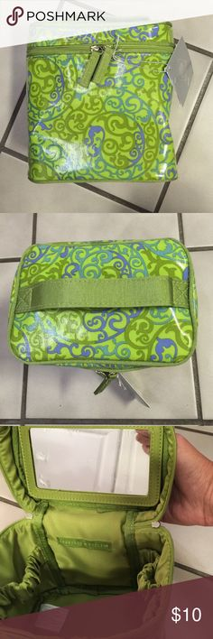 """Crabtree & Evelyn Toiletry Cosmetic Travel Bag Laminated fabric. 6"""" wide, 6 1/2"""" tall and 4"""" deep. Bag was part of the Summer Hill giftset. The tag is still affixed and the bag unused. This is for the bag only. Plastic protector is still on the removable/velcro mirror. There are five elastic stabilizing bands to keep your items upright and still room for your other items. Interior is a lime green satin-like fabric. Crabtree & Evelyn  Bags Cosmetic Bags & Cases"""