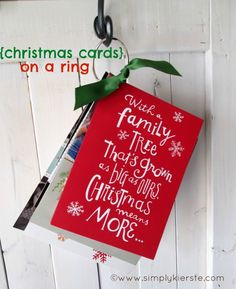 {christmas cards on a ring} Punch a hole in the corner of all the cards you receive and display them on a book ring. Love this idea!