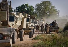 Soldiers of the Somali National Army (SNA) dismount from a fighting vehicle alongside an armoured colomn of the African Union Mission in Somalia (AMISOM) in the town of Jawahar in Middle Shabelle region 10 December 2010, north of the Somali capital Mogadisu. SNA forces supported by AMISOM captured the town of Jawahar, 90km north of Mogadishu, on 9 December from the Al-Qaeda-affiliated extremist group Al Shabaab. AU-UN IST PHOTO / STUART PRICE.