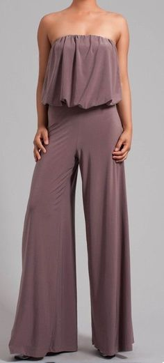 THE PARTY JUMPSUIT It is all about the jumpsuits this season!! This jumpsuit is so chic and comfortable! Elastic at the top of the bust goes all the way around. Nice loose fitting bust hangs perfectly thanks to the weight of the material.