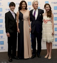 Supportive family: Michael Douglas's wife Catherine Zeta-Jones and children Dylan, 14, and Carys, 12, were by his side on Thursday as he received the Genesis Prize in Israel