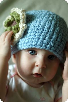 Those hair bows with the giant flowers on them, no thanks, but these knit hats are sooo cute.