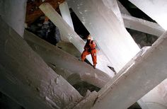 Cave of Crystals, Chihuahua, Mexico  Nearly 1,000 feet beneath Mexico's Naica silver mine, in the Cave of Crystals, are 36-foot obelisks of solid crystal gypsums - the largest on Earth. For roughly half a million years, the crystals formed. Nearby magma deposits heat the cavern to temperatures of up to 112 degrees Fahrenheit and the entire space was flooded with mineral-rich waters up until recently. The chamber was discovered in 2000, after mining operations pumped it dry.