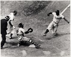 Jackie Robinson sliding into home against Yankees catcher Yogi Berra