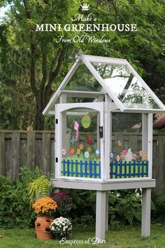 How to use old house windows to create a mini greenhouse for the garden
