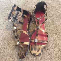 Size 7.5 Nine West ankle sandals Cheetah/leopard print saddled with gold accents. Excellent condition worn once Nine West Shoes Sandals