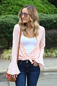Blush Pink top for spring https://freetomoveclothing.com/collections/tops/products/shes-got-secrets-embroidered-top