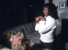 1976: Staring down the dogs at home.