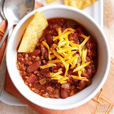 Big-Batch Vegetarian Lentil Chili- Red lentils blend right in with classic chili ingredients such as diced tomatoes, kidney beans, and chopped veggies in this hearty, meatless dish. High Protein Vegetarian Recipes, Vegetarian Chili, Vegan Recipes, Cooking Recipes, Veggie Chili, Meatless Chili, Chili Soup, Bean Chili, Turkey Chili