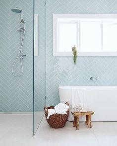 Herringbone tile pattern in light blue on modern bathroom wall. Beach Bathrooms, Upstairs Bathrooms, Boho Bathroom, Bathroom Wall, Master Bathroom, Best Tiles For Bathroom, Accent Tile Bathroom, Beachy Bathroom Ideas, Metro Tiles Bathroom
