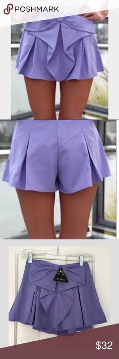 "NWT Imprint Purple Skort This beautiful skort has a very flattering fit, just unfortunately a little bit too large on me so I have to sell them! It is AUS size 6 (US Size 2) / waist 26"" length 14.5"". Best offers are considered. Please let me know if I can answer any of your questions or if you would like additional photos! IMPRINT Shorts Skorts"