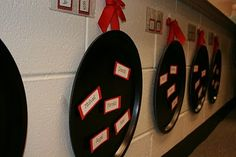 Paint pizza pans (can buy them at a dollar store) and use as a way to organize small groups and change as necessary.