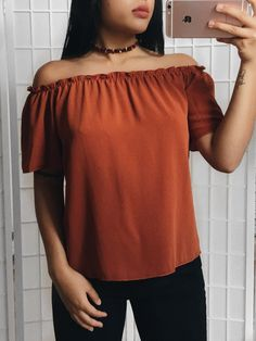 Solid chiffon open shoulder top. 95% polyester 5% Spandex Made in USA