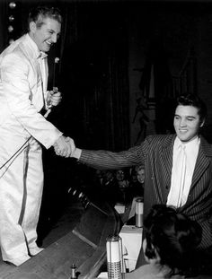Elvis in the audience, is greeted by Liberace at the Frontier Hotel, Las Vegas