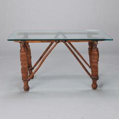 """Cocktail Table with 19th Century African Wood and Leather Base -- Glass top cocktail table with circa 1890s base made from wood hand carved North African elements bound with leather.  Base Only:  34.5"""" w x 21.4"""" h x 35"""" d  Top Only:  38.5"""" w x 24"""" h x .5"""" d --  Item:  5744 -- Retail Price:   $2495"""