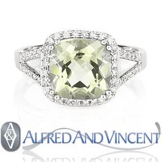 The featured ring showcases a square cushion cut green amethyst set in a 14k white gold halo & splitshank setting adorned with round cut diamond accents.
