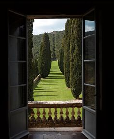The view at Villa Cetinale is artfully lined with towering cypresses, olive trees and impeccable gardens